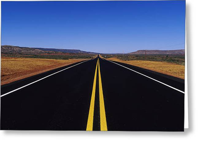 Yellow Line Greeting Cards - Highway Passing Through A Landscape Greeting Card by Panoramic Images