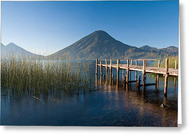 Panorama Mountain Images Greeting Cards - Jetty In A Lake With A Mountain Range Greeting Card by Panoramic Images