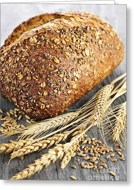 Bun Photographs Greeting Cards - Loaf of multigrain bread Greeting Card by Elena Elisseeva