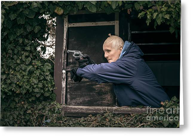Escapees Photographs Greeting Cards - Masked senior man aiming a gun Greeting Card by Jan Mika