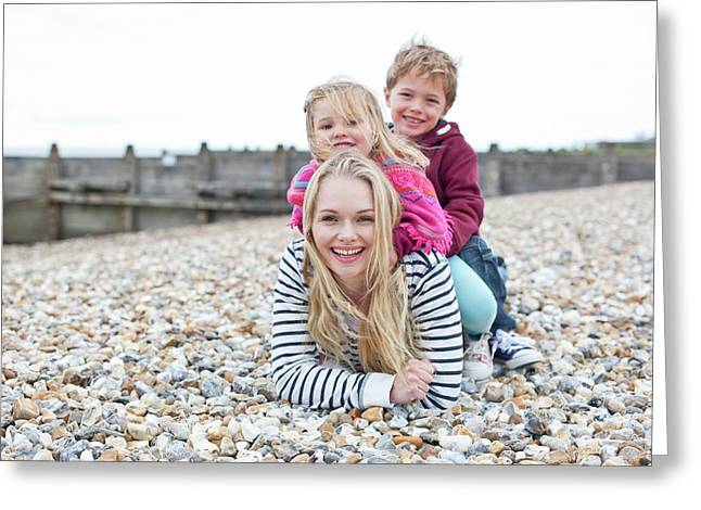 Mother With Children On Beach Greeting Card by Ian Hooton