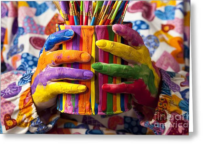 Paint Cans Greeting Cards - Multicolored Painted Fingers Holding Greeting Card by Jim Corwin