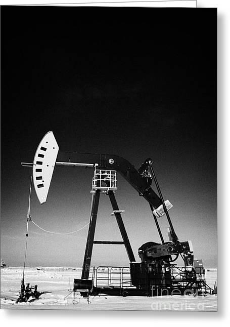 Pumping Unit Greeting Cards - oil pumpjack in winter snow Forget Saskatchewan Canada Greeting Card by Joe Fox
