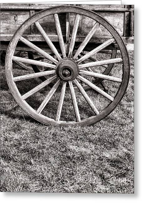 Wagon Wheels Photographs Greeting Cards - Old Wagon Wheel on Cart Greeting Card by Olivier Le Queinec