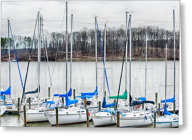 Charlotte Greeting Cards - Parked Yachts In Harbour With Cloudy Skies Greeting Card by Alexandr Grichenko