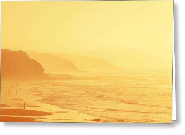 Foggy Beach Greeting Cards - people in Sopelana beach with haze Greeting Card by Mikel Martinez de Osaba
