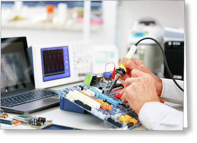 Person Repairing Electronic Circuit Board Greeting Card by Wladimir Bulgar