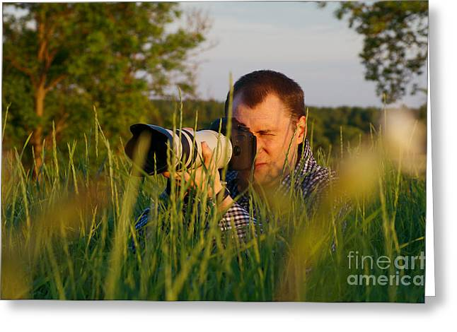 One Photograph Greeting Cards - Photographer looks at camera Greeting Card by Aleksey Tugolukov