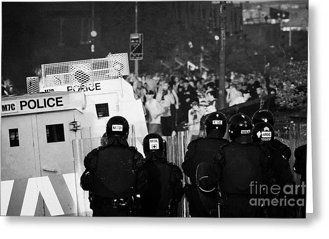 Protest Greeting Cards - PSNI riot officers face rioters mob on crumlin road at ardoyne shops belfast 12th July Greeting Card by Joe Fox