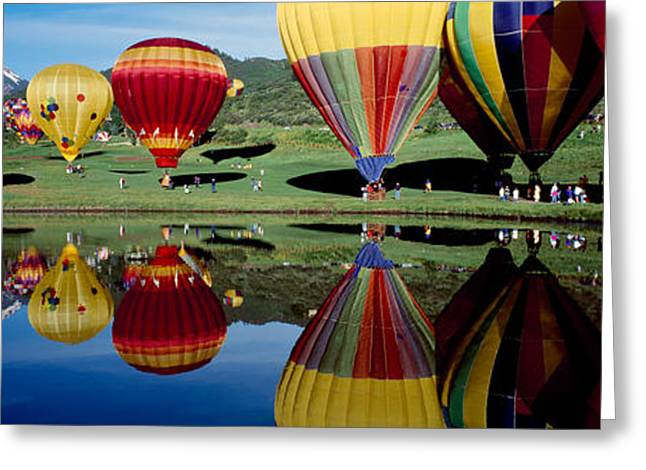 Ballooning Greeting Cards - Reflection Of Hot Air Balloons Greeting Card by Panoramic Images