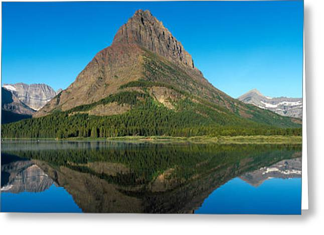 Many Glacier Greeting Cards - Reflection Of Mountains In A Lake Greeting Card by Panoramic Images