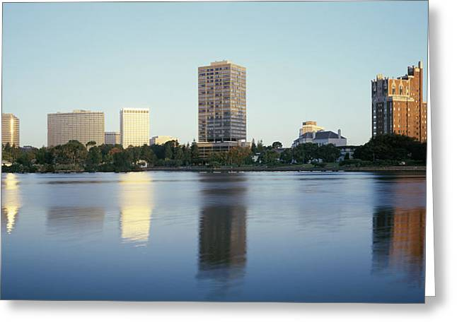 Merritt Greeting Cards - Reflection Of Skyscrapers In A Lake Greeting Card by Panoramic Images