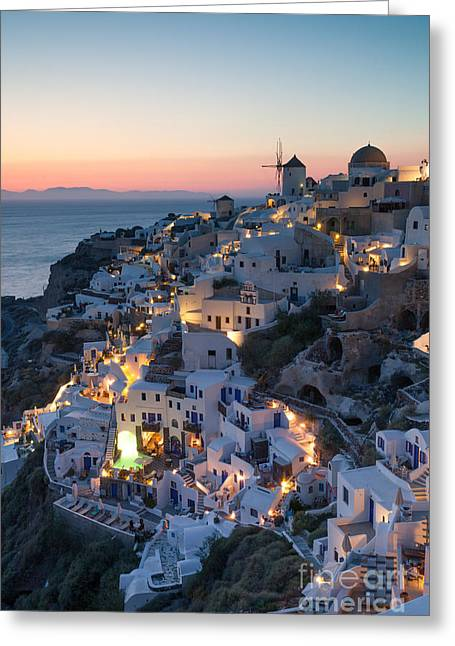 Santorini Greeting Cards - Romantic sunset over the village of Oia Greece Santorini Greeting Card by Matteo Colombo