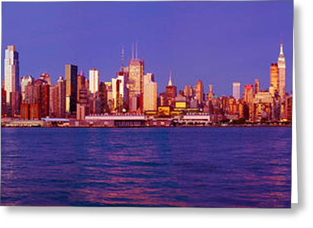 Midtown Greeting Cards - Skyscrapers At The Waterfront, Midtown Greeting Card by Panoramic Images