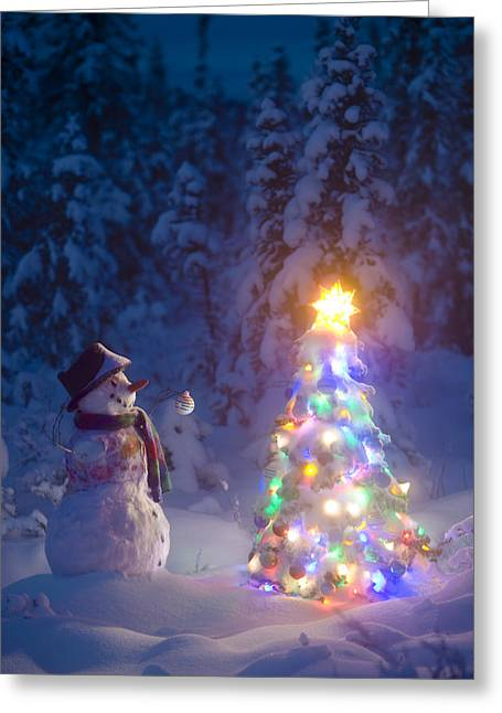 Snowy Night Night Greeting Cards - Snowman Stands In A Snowcovered Spruce Greeting Card by Kevin Smith