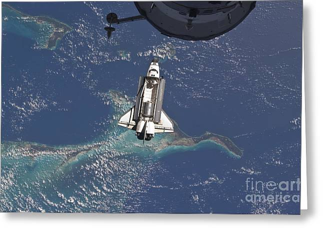 Atlantis Greeting Cards - Space Shuttle Atlantis Over The Bahamas Greeting Card by Stocktrek Images