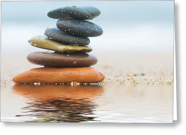 Stack Of Beach Stones On Sand Greeting Card by Michal Bednarek