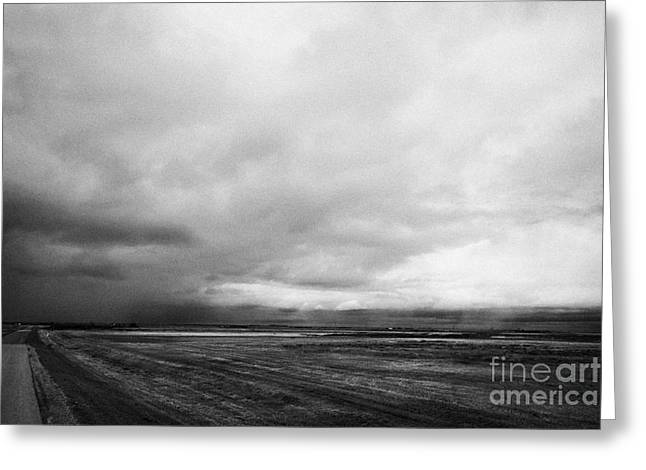 Winter Storm Greeting Cards - storm snow clouds forming over the prairies assiniboia Saskatchewan Canada Greeting Card by Joe Fox