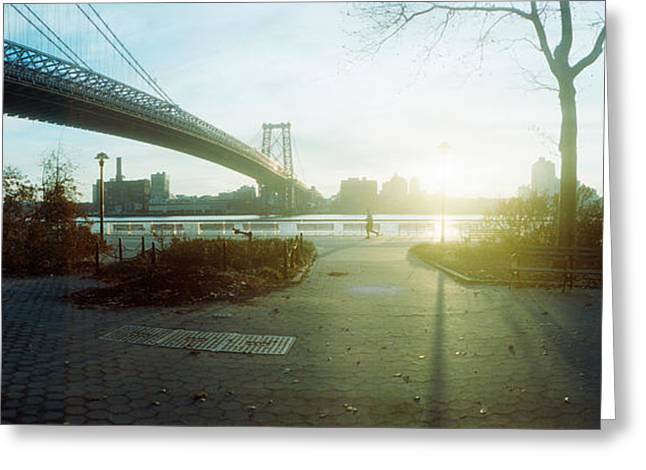 Backlit Greeting Cards - Suspension Bridge Over A River Greeting Card by Panoramic Images