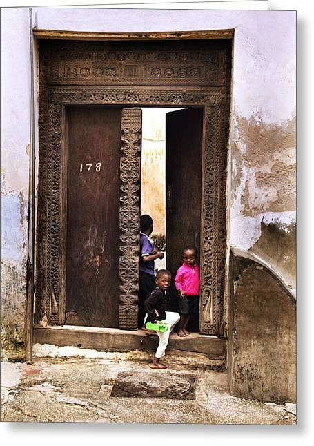 Teen Town Greeting Cards - Kids Playing in Famous Zanzibar Doorway Marhaba Greeting Card by Nasser Studios