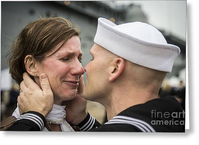 Embrace Greeting Cards - U.s. Navy Sailor Kisses His Wife Greeting Card by Stocktrek Images