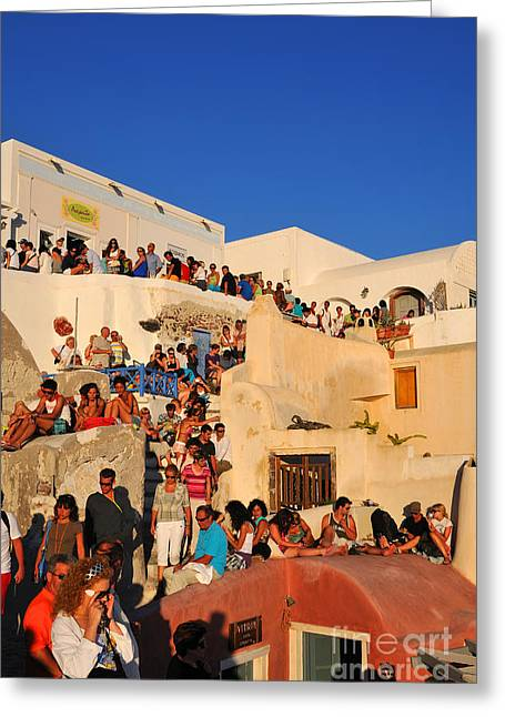 Town Greeting Cards - Waiting for the sunset in Oia town Greeting Card by George Atsametakis
