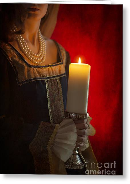 Gold Necklace Greeting Cards - Woman In A Blue Medieval Dress Holding A Candle Greeting Card by Lee Avison