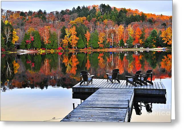 Wilderness Greeting Cards - Wooden dock on autumn lake Greeting Card by Elena Elisseeva