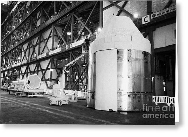 Command Center Greeting Cards - worker works on mockup of the nasa orion command and service modules Kennedy Space Center Florida US Greeting Card by Joe Fox