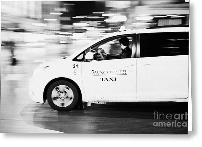 Speeding Taxi Greeting Cards - yellow cab taxi downtown Vancouver city at night BC Canada deliberate motion blur Greeting Card by Joe Fox