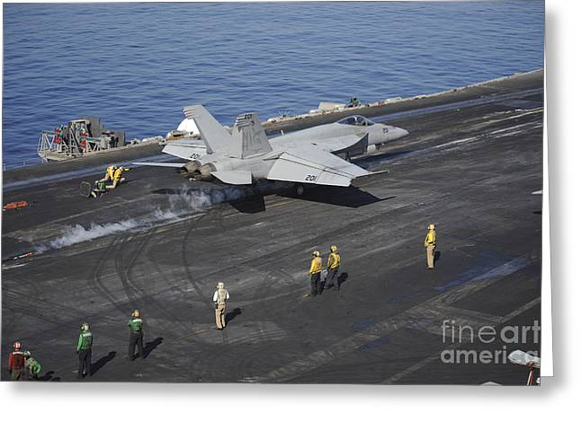 Military Airplanes Greeting Cards - An Fa-18e Super Hornet Launches Greeting Card by Stocktrek Images