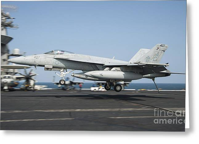 Military Airplanes Greeting Cards - An Fa-18e Super Hornet Lands Aboard Uss Greeting Card by Stocktrek Images