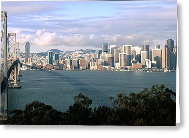 San Francisco Bay Greeting Cards - Bridge Across A Bay With City Skyline Greeting Card by Panoramic Images