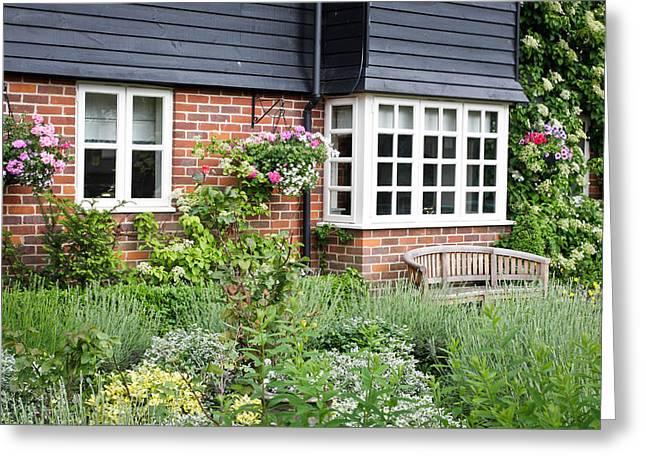 Garden Scene Greeting Cards - Cottage garden Greeting Card by Tom Gowanlock