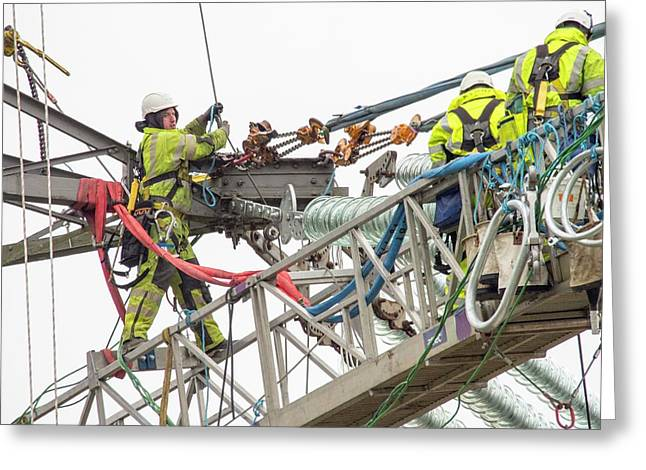 Engineers Working On Electricity Wires Greeting Card by Ashley Cooper