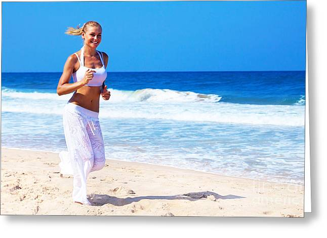 Sportswoman Greeting Cards - Healthy woman running on the beach Greeting Card by Anna Omelchenko