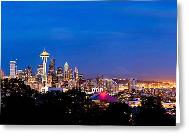 Ocean Photography Greeting Cards - High Angle View Of A City At Dusk Greeting Card by Panoramic Images