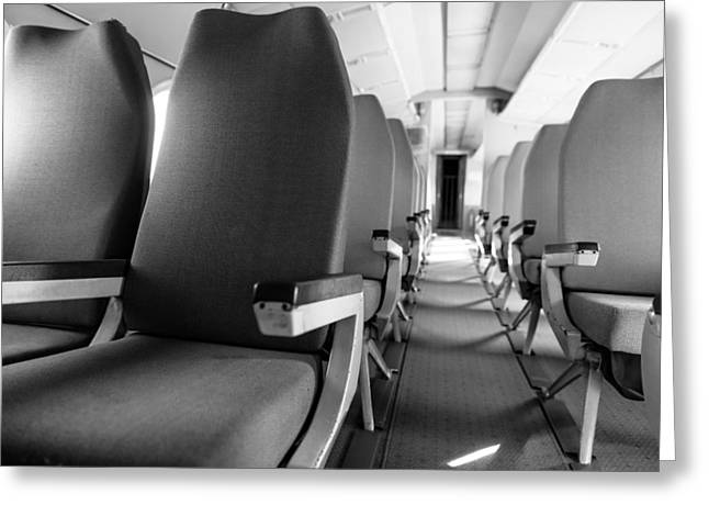 Seated Pyrography Greeting Cards - Interior of an airplane with many seats Greeting Card by Oliver Sved