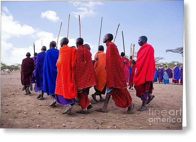 Maasai Men In Their Ritual Dance In Their Village In Tanzania Greeting Card by Michal Bednarek