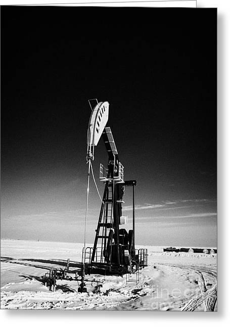 Pumping Unit Greeting Cards - oil pumpjack in winter snow Forget Saskatchewan Greeting Card by Joe Fox