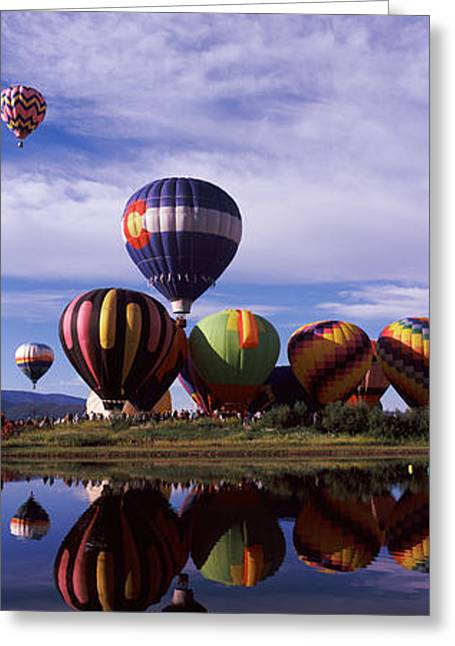 Steamboat Springs Greeting Cards - Reflection Of Hot Air Balloons Greeting Card by Panoramic Images