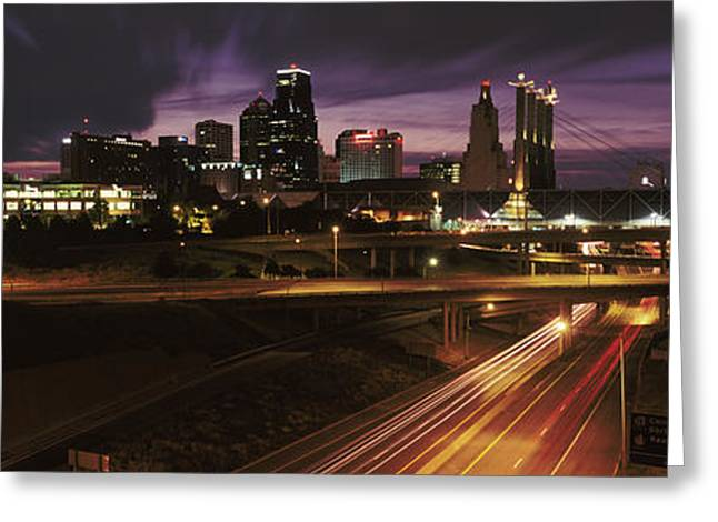 Jackson County Greeting Cards - Skyscrapers Lit Up At Night In A City Greeting Card by Panoramic Images