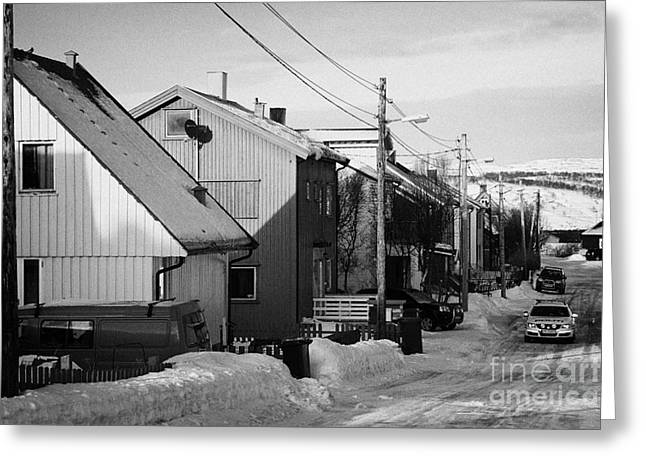 Finnmark Greeting Cards - Snow Covered Street Of Traditional Wooden Houses In Kirkenes Finnmark Norway Europe Greeting Card by Joe Fox