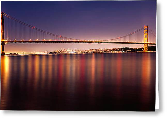 San Francisco Bay Greeting Cards - Suspension Bridge Lit Up At Dusk Greeting Card by Panoramic Images
