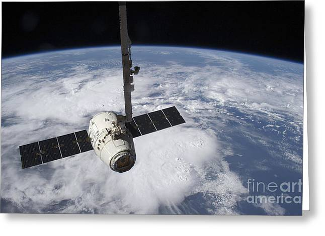 Capsule Greeting Cards - The Spacex Dragon Cargo Craft  Prior Greeting Card by Stocktrek Images