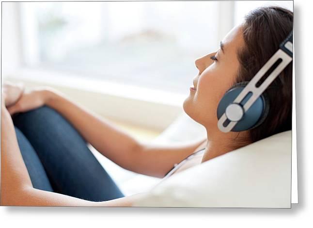 Woman Wearing Headphones Greeting Card by Ian Hooton