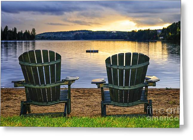 Pairs Greeting Cards - Wooden chairs at sunset on beach Greeting Card by Elena Elisseeva