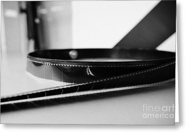 Unwind Photographs Greeting Cards - 35mm cinema film unwound on spool in old cinema projection room Biggar Saskatchewan Canada Greeting Card by Joe Fox