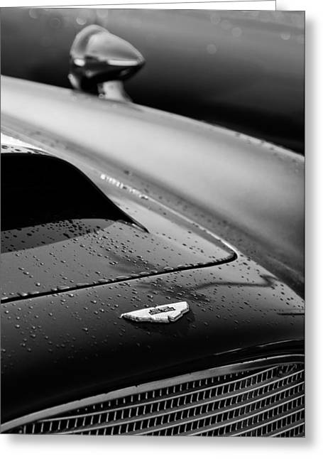 Transportation Greeting Cards - 1959 Aston Martin Db4 Gt Hood Emblem Greeting Card by Jill Reger