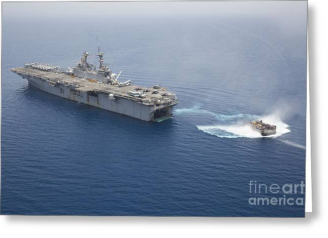 Amphibious Assault Ships Greeting Cards - A Landing Craft Air Cushion Approaches Greeting Card by Stocktrek Images
